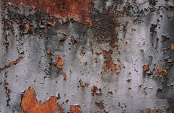 Old corroded metal wall background with flaky gray paint. Rusty flaky cracked metal surface.