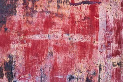 Old corroded metal with worn red paint, grunge background or texture