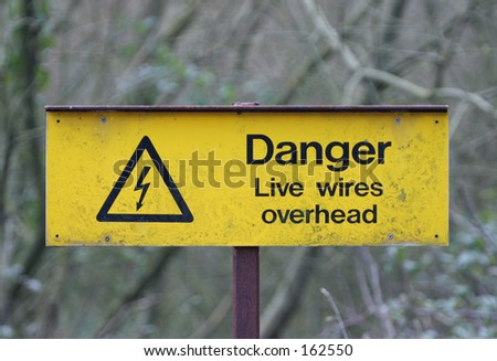 Old Corroded Sign, Danger Live Wires Overhead