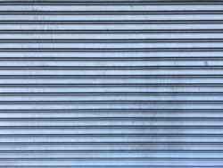 Old corrugated sheet metal door, galvanized iron sheet texture background.