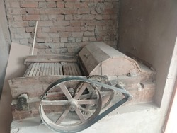 Old cotton gin machine. The cotton engine or cotton gin, that is used to separate the cotton fibers from the seedpods.
