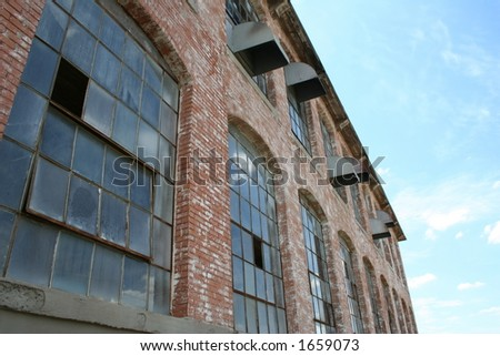 old cotton mill building with...