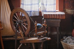 Old country house with antique spinning wheel