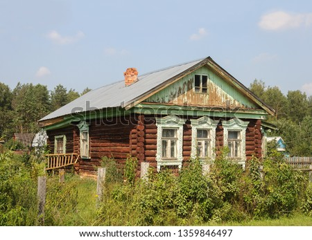 Old country wooden house with carved windows in russian village, Vladimir region. Sunny summer day.