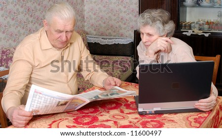old couple reading hot news