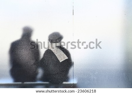 Old couple sitting in a bus stop.