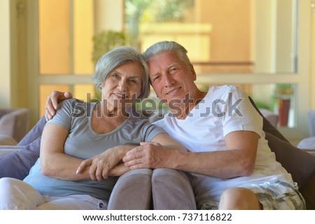 old couple sitting on sofa  #737116822