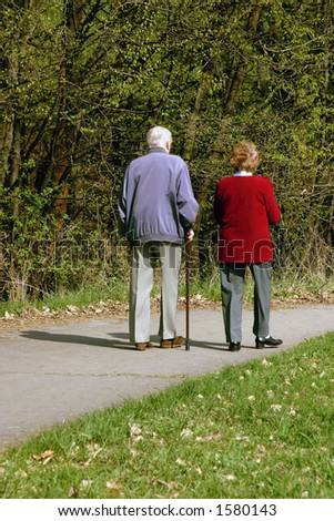 Old couple walking together in park