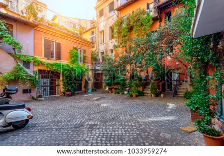Old courtyard in Rome, Italy. Architecture and landmark of Rome. Postcard of Rome. #1033959274