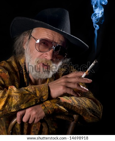Old cowboy smoking