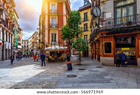 Old cozy street in Madrid, Spain. Architecture and landmark of Madrid, postcard of Madrid  #566971969