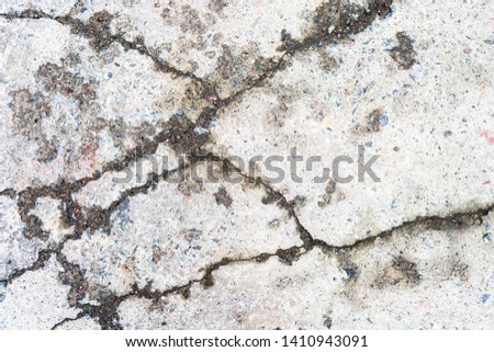 Old cracked asphalt with cracks. Abstract background. #1410943091