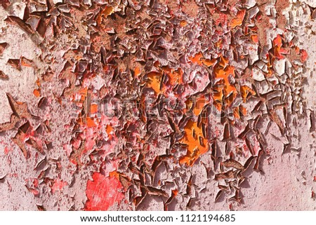 Old cracked paint on the concrete wall. Texture, pattern, background. The wall cracked with paint, abstract paint behind the iron. With a pink color, the paint eventually peels off.