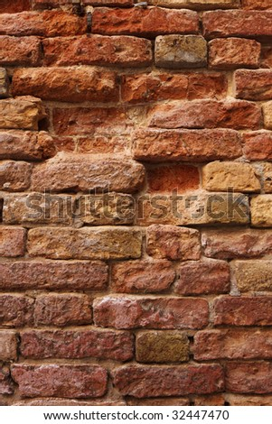 old cracked rough red bricks texture