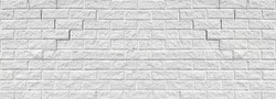 Old cracked white brick wall wide texture. Rough light gray weathered masonry background