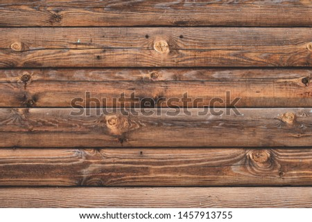 Old cracked wooden boards, brown planks. Surface of shabby weathered parquet. Woody grunge surface, rustic barn. Dirty grain timber, weathered oak. Vintage pattern background. Messy planking.