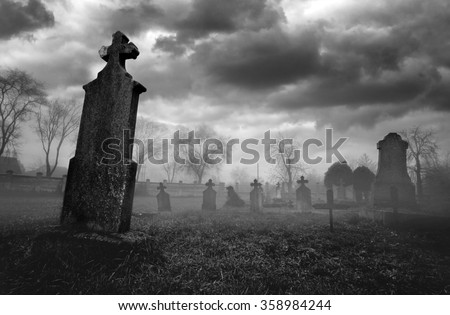 Old creepy graveyard on stormy winter day in black and white. Foto stock ©