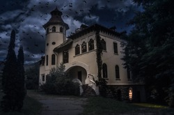 Old creepy house with spooky details dark horror atmosphere. Haunted house scene with many crows and black cat like in Halloween movies. Frightful manor with strange light in the ghost tour journey