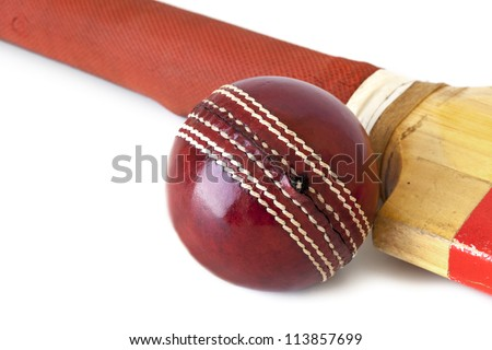 Old cricket bat and cricket ball, over white background.