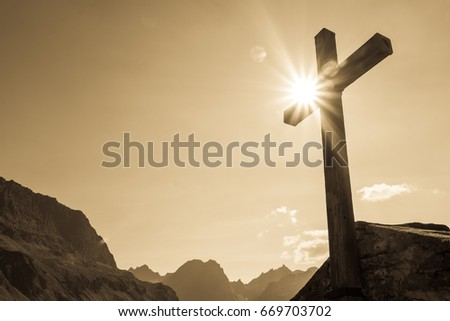 old cross at a cemetery #669703702