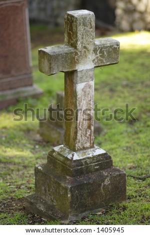 Old cross shaped headstone, DOF focus on cross.