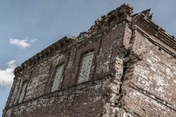 old crumbling brick building, dilapidated, abandoned