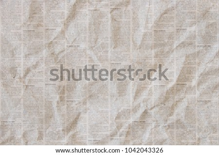 Old crumpled grunge newspaper paper texture background. Blurred vintage newspaper background. Crumpled paper textured page. Gray brown beige collage news paper background.
