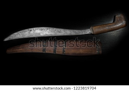 Old curve combat knife, scimitar, curved blade, wooden handle on black isolated background #1223819704