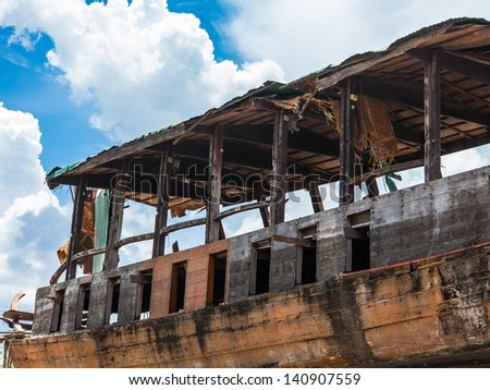 Old damage boat in sunny day #140907559