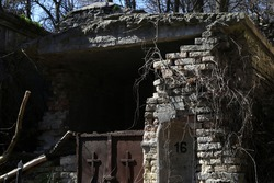 old damaged brick crypt in the cemetery