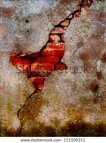Old damaged plaster on a brick wall
