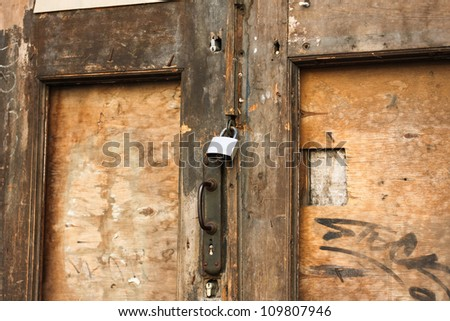 Old damaged wooden door with locks