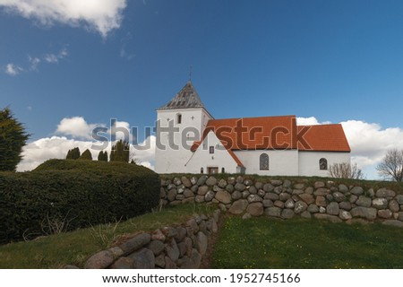 Old Danish church in central Jutland. Built approx. year 1400. The old cemetery thoughts, and memories from ancient times stock photo