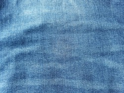 Old dark blue jeans seamless and patterned, denim texture background.