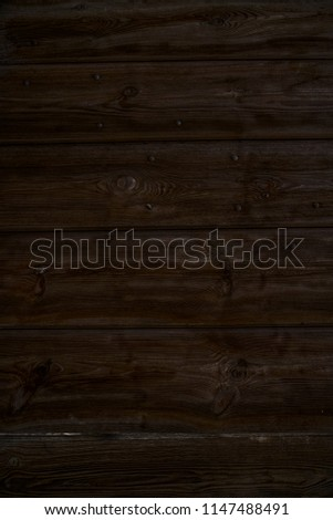 Old dark cherry wood background. Red wooden board plank texture. Beautiful natural rustic photo backdrop for vintage hipster design #1147488491