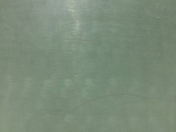 Old dark green plastic surface background texture