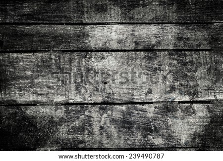 Old  dark  grunge wood background with knots and scratches.