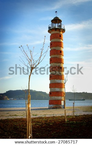Old deactivated lighthouse in Lisbon by the Tagus river