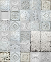 Old decorative painted tin ceiling tiles.