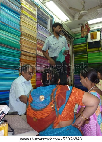 OLD DELHI, INDIA - NOV 3  -Indian women choose from hundreds of colors in a textile shop near Chandri Chowk on Nov 3, 2009, in Delhi, India.