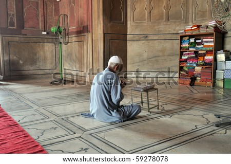 OLD DELHI, INDIA - 24 OCTOBER: An unidentified muslim man prays in Jama Masjid Mosque in Old Delhi on October 24, 2009. Muslim religion is still increasing across the whole India.
