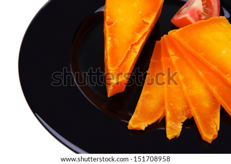 old delicious cheddar cheese chop with slice on black plate isolated over white background stock photo
