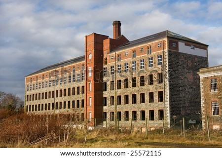 old derelict mill laying abandoned in countryside - stock photo