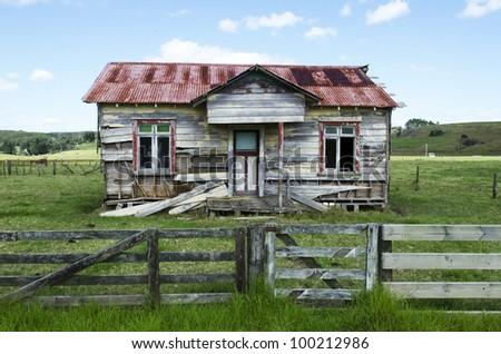 Old deserted wooden farm house.