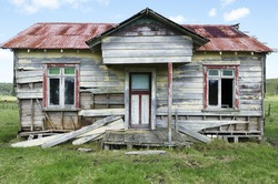 Old deserted wooden farm house in Northland New Zealand. No People. Copy space
