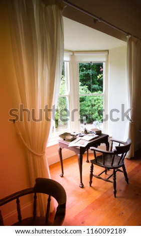 Old desk with relaxed views of the garden #1160092189
