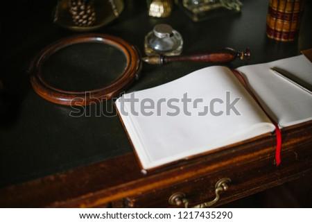 Old desk with scrapbook #1217435290