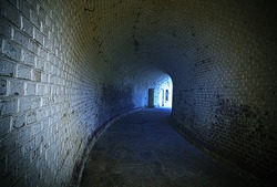 Old desolated tunnel with blue glowing effect, HDR processing.