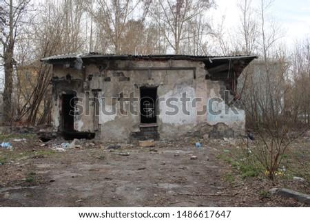 old destroyed building with broken broken broken glass in the Windows non-residential premises house with dangerous debris falls #1486617647