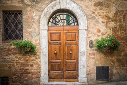 Old destroyed door to the Tuscan home